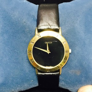 This auction is for an authentic Vintage 1990's Men's Gold Gucci Wristwatch on a beautiful brand new black real leather men's band. The watch is the rare model #SCX33 This watch is serial numbered and recently cleaned & serviced with a brand new battery installed. We can also have it polished before it is sent out for a small fee. Come by and try it on or trade yours at Trade Nation in downtown Jeffersonville, IN 47130 from 10am - 6pm Tuesday through Saturday!